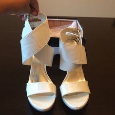 White cross cross, wrap around ankle heels! Definitely a showstopper and super comfy! They are waiting on you to pair with the perfect  dress! Anne Michelle Shoes Platforms