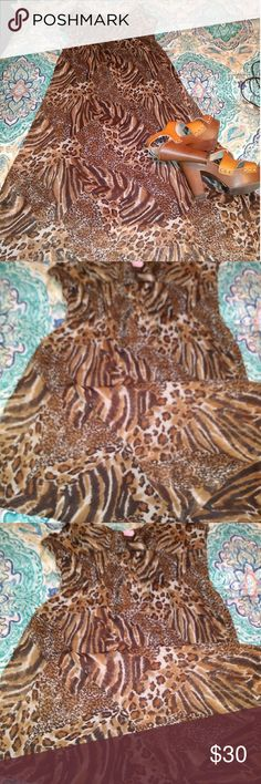 Mixed animal print maxi midi dress Mixed Animal print (cheetah spot/ tiger stripe etc) chiffon like see through layer with stretchy black lining.  Dress is to my ankles but I'm short. So its maybe more calf length for a taller person.  Size 5 but has cinched waist and a lot of give. She's Cool Dresses Midi