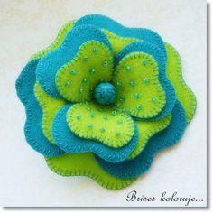 Felt flower brooch by Anna Zaprzelska, via Flickr