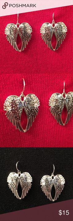 """Pierced Earrings Angel Wings silver tone/black Pierced Earrings Angel Wings silver tone/black.  Approximately 1"""" x 1"""". Wide and tall does not the wire.  Beautiful markings.  Lead compliant. Jewelry Earrings"""
