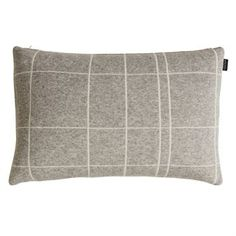 The Square pillow from the Danish brand OYOY is a soft, structured pillow made of lambswool mix. The cushion is reversible, meaning that you can either choose to display the grey or the white side – a great way to switch up the look of your sofa or bed with little to no effort! The pillow is great in combination with other pieces from the OYOY range.