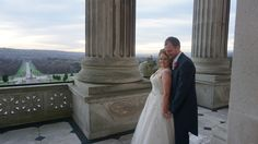 The beautiful bride and groom getting photographs on the balcony of Parliament Buildings