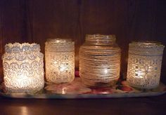 Lace covered mason jars with candles! Perfect decorations!!