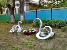 Tire Art Planters | tire art planters | recycled car tire sculptures 2 None of these tires ...