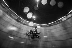 A stuntman rides his motorcycle on the walls of an empty well in this National Geographic Your Shot Photo of the Day.