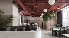 The offices for Vizor, an interactive game development company based in Minsk, Belarus, were designed by local design studio, STUDIO11, as an homage to the soviet era construction of the existing space while, at the same time, creating and providing their clients with a thoroughly modern and functional office that met their dynamic needs to a T.