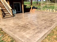 Wood stamps are becoming a popular choice for homeowners who like the look of wood decking but don't want to deal with the upkeep and deterioration. As a bonus, woodplank stamp patios won't cause splinters on bare feet. This patio was designed by Blackwater Concrete