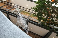 Wire bird sculptures decorate the main reception area.  Project specifications, such as #swiftbricks, help endangered and dwindling species