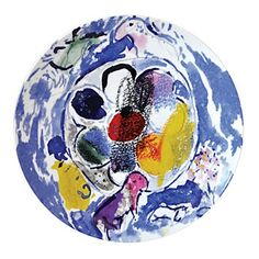 """Bernardaud Marc Chagall Coupe Plate, Set of 6, $570, Bloomingdale's. """"Incorporating art is a cutting edge way to add patterns to your table setting. Bernardaud's new collection celebrates painter Marc Chagall's iconic stained-glass windows by featuring his artwork on salad/dessert plates, serving pieces, and more."""" -- -- Emily Hull-Martin, Bloomingdale's fashion director for home"""