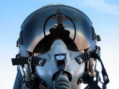 KC-10 reflection in the visor of an F-15C Eagle pilot.