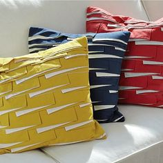 Love these crooked pleated pillows