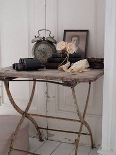 An old luggage rack topped with barn board creates a unique table!