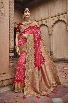Pink and red silk traditional saree with a matching red silk blouse. #banarasisarees #banarasisareelookforwedding #banarasisareeblousedesign #banarasisilksaree #banarasisareeblousedesignslatest #sareestyles #saree #sareewedding #sareegown #sareedesignspartywear #indianweddingoutfits #indianfashion #indiandesignerwear #indianbridalfashion #weddingdresses #wedding #bridalblousedesigns Latest Silk Sarees, Indian Silk Sarees, Indian Sarees Online, Art Silk Sarees, Banarasi Sarees, Wedding Saree Blouse, Traditional Silk Saree, Work Sarees, Silk Material