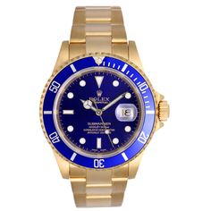 Rolex Yellow Gold Submariner Wristwatch with Blue Dial Ref 16618 | From a unique collection of vintage wrist watches at http://www.1stdibs.com/jewelry/watches/wrist-watches/