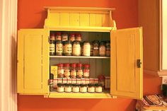 25 Best Ways to Organize (Spices Storage Solution)  Yes, 25 different ways to store spices, but I love this cute cupboard! It would be perfect in my kitchen.