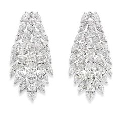 Pair of Diamond Cluster Pendant-Earrings   Platinum, the tapering cluster centering 18 oval diamonds, highlighted by 2 oval diamonds* approximately 4.12 cts., edged by 24 marquise and 10 pear-shaped diamonds