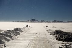 Credit: Kevin Rushby Approaching 5,000m the road is covered in ice and strong winds laden with ice particles scour the landscape
