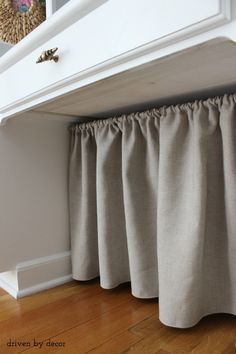what about a curtain or some kind of fabric design to hide washer pipes?