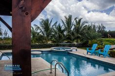 Constructed on Grand Cayman by Cayman Structural Group, Ltd. Grand Cayman Island, Cayman Islands, Swimming Pool Designs, Swimming Pools, Concrete Pool, Construction Services, Group, Beach, Outdoor Decor