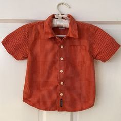 Toddler Boys timeless button down Toddler Boys timeless button down shirt in orange plaid. No visible signs of wear. Please poke through my closet for great bundling items to save some$$. Old Navy Tops Button Down Shirts