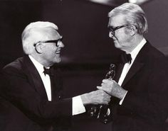 Cary Grant gives Jimmy Stewart his Honorary Oscar at the 1985 Academy Awards.
