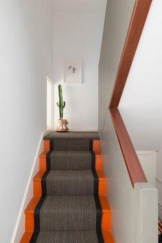 "It's my personal belief that the smallest spaces have the biggest impact. The ""utility"" areas of your home–the hallway, mudroom and, yes, the staircase–don't get used as often as, say, the living room. But that means you have license to have even more fun with their decor. Take your stairs and add a crazy pop of color."