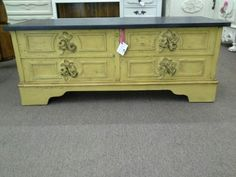 $145 - Vintage cedar chest painted a mustard yellow, distressed with rose bouquet applied to front; flat black top. Inside is a natural cedar. ***** In Booth H12 at Main Street Antique Mall 7260 E Main St (east of Power RD on MAIN STREET) Mesa Az 85207 **** Open 7 days a week 10:00AM-5:30PM **** Call for more information 480 924 1122 **** We Accept cash, debit, VISA, Mastercard, Discover or American Express