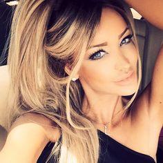 Luxury/glam make up nude lips heavy eyes.
