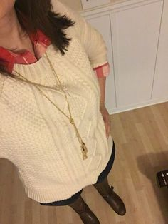 Cable knit sweater, red plaid shirt, dark skinnies, brown riding boots, tassel necklace