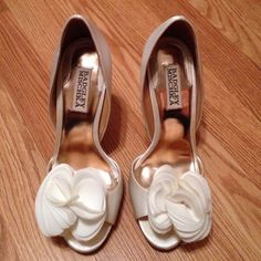 Badgley Mischka Randall White Satin Bridal Shoes Purchased for wedding day and wore for only a couple of hours.  Round open toe with beautiful rosette vamp detail.  The heel is 4.5 inches high.  Purchase comes with dust bag, box and extra heel pads. Badgley Mischka Shoes