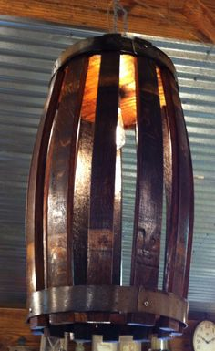 Beautiful custom made wine barrel light fixture. About 26 inches tall, and about a 12 inch diameter.