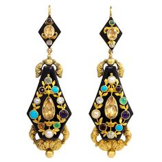 Antique Onyx Multi-Gemstone Gold Pendant Earrings. A pair of antique gold pendant earrings comprised of a carved onyx plaque with repoussé embellishment and set with topaz, pearl, ruby, chrysophrase, amethyst, turquoise, emerald, garnet and diamond in a garland wreath, in 18k. c 1830