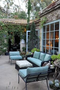 pretty patio with blue cushions and window trim