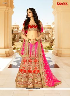 Elegance and honourable come together in this beautiful drape. Be the sunshine of every person's eyes dressed with this desirable hot pink and red net a line lehenga choli. This engaging attire is d...