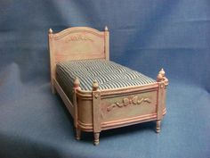 How to make a miniature dollhouse  bed using card stock and making a mattress with no sewing.
