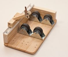 easy glass bottle cutter made up of common parts, also like the basic idea to use for marking / cutting larger cylinders
