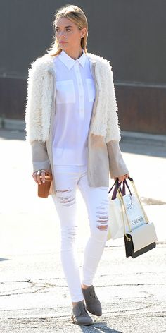 Jaime King looks flawless in a white blouse, white jeans, and fuzzy white coat
