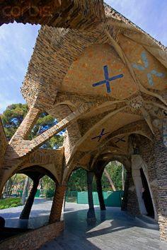 Priest at Doorway to Colònia Güell Church. Gaudí. Catalonia.