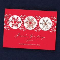 Snowflake Front Imprint Holiday Card Catch the attention of everyone on your list this holiday season! Bright red frames a trio of ornately decorated snowflakes, with your business imprint prominently printed at the bottom of this striking holiday card.