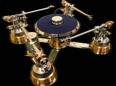 The Angelis Labor Gabriel turntable features four separate arms that sit on a platter suspended on a magnetically levitated spindle. The materials used in the making include aluminum, bronze and stainless steel. The turntable and arm are totally decoupled at several points, under the base, turntable and the pin. The orbital starship-like turntable combines state-of-the-art technology with a stunning form factor. Pricing for the Angelis Labor Gabriel turntable falls between 27,000 and 64,000K