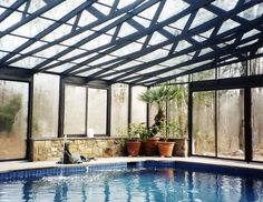Enjoy your pool even in the rain with a glass atrium pool enclosure! #modern #contemporary #architecture