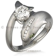 dolphin engagement ring this sculptural engagement ring shows a dolphin elegantly supporting a center diamond - Dolphin Wedding Rings