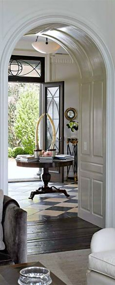So many wonderful things going on - transitional floors, arches, decorative glass and doors ... Love,,,let's not forget those horns...AWESOME display