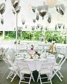 Balloon Decorations    Solitary dahlias and mums in minimalist modern vases make for elegant centerpieces, while silver Mylar heart balloons tied to the chairs raise spirits at Sarah and Dominick's whimsical wedding