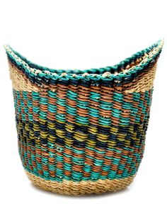 Woven Basket: We are always looking for attractive catchalls, and this colorful basket ($20), made from dyed elephant grass, is a great size for an entry console or a bathroom shelf.