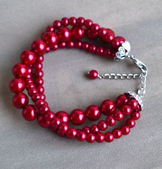 I make the bracelet to use 6mm and 10mm burgundy red glass pearls.The bracelet lengh is 8 inches ,It is fit to 6.5-7 inches wrist,IT has a 2