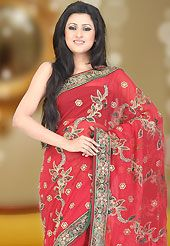 Style and trend will be at the peak of your beauty when you adorn this saree. This red faux georgette saree have beautiful embroidery patch work which is embellished with resham, zari, sequins, stone and cutdana work. This saree gives you a modern and different look in fabulous style. Matching blouse is available. Slight Color variations are possible due to differing screen and photograph resolutions.