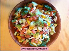 Very easy summer salad ~ Greens, cucumber, yellow bell pepper; avocado, almonds, shredded carrots, beets and cabbage. Sprinkled with chili powder and lime juice. #Health #fitness #raw #vegan www.BodaciousLiving.com