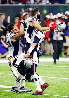 Tom Brady of the New England Patriots celebrates with Julian Edelman after defeating the Atlanta Falcons 3428 in overtime to win Super Bowl 51 at NRG.