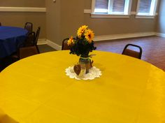 yellow and royal blue with sunflower/mason jar centerpieces for tables